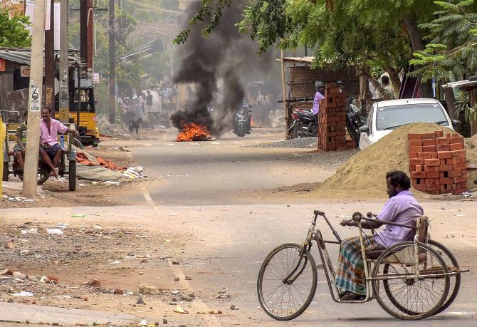 Protesters burn tyres to block a road during the protest demanding the closure of the Sterlite factory in Tuticorin, May 22, 2018.