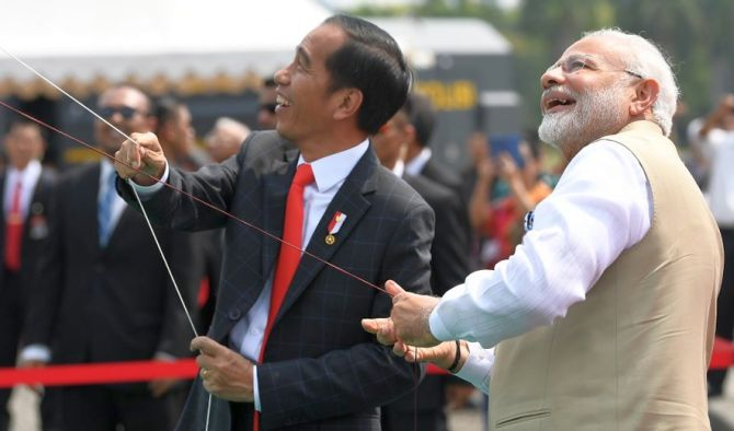 India News - Latest World & Political News - Current News Headlines in India - Flying kites, visit to mosque: All in a day's work for PM in Indonesia