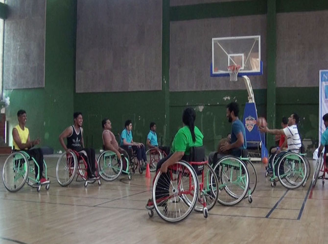 Video: A basketball camp for the wheelchair-bound