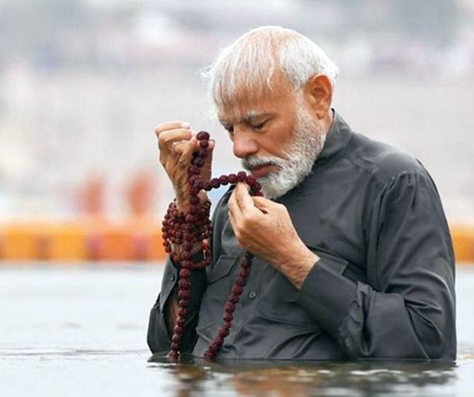 Image result for PM Modi Kumbh Dip