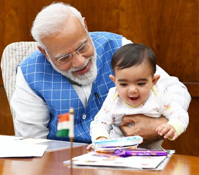 Modi has 'aww' moment with baby in Parliament