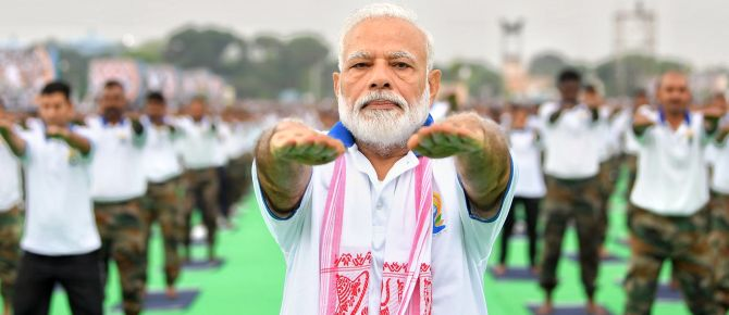 PHOTOS: Modi leads the way at Yoga Day event