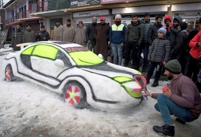 PHOTOS: Kashmiri youth builds car out of snow