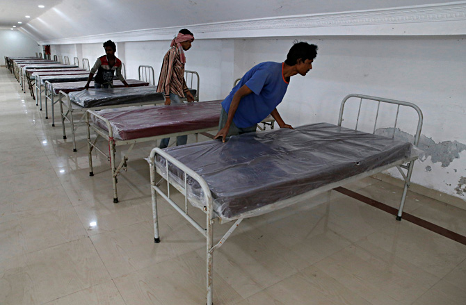 Workers prepare beds to set up a quarantine facility amid concerns about the spread of coronavirus in Howrah on the outskirts of Kolkata, March 19, 2020. Photograph: Rupak De Chowdhuri/Reuters