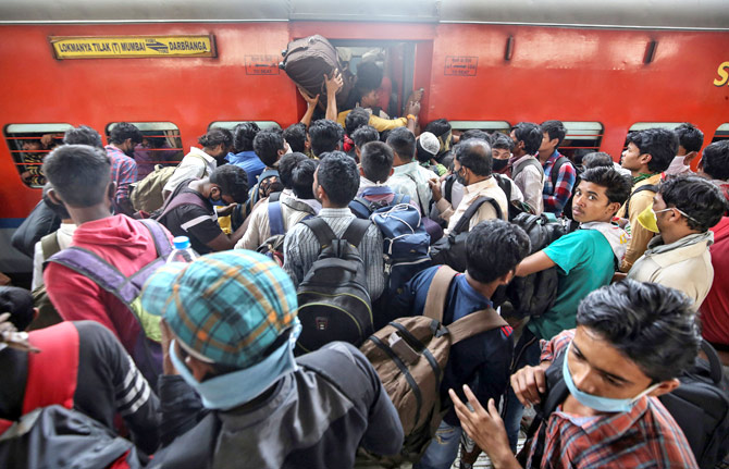 Migrant workers and their families board an overcrowded passenger train, after the Maharashtra government imposed restrictions on public gatherings in attempts to prevent the spread of coronavirus in Mumbai, March 21, 2020. Photograph: Prashant Waydande/Reuters