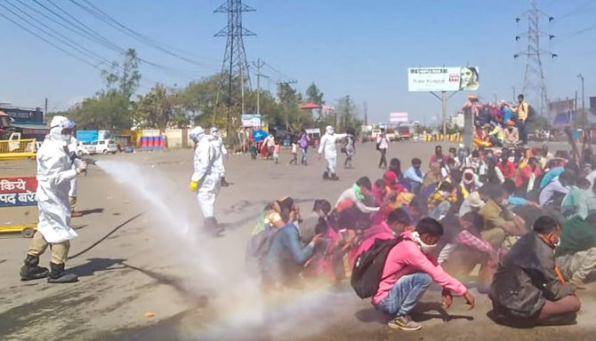 Migrants sprayed with 'disinfectant' in Bareilly