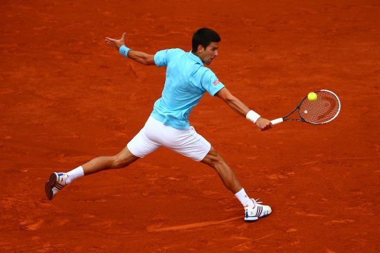 Novak Djokovic of Serbia returns a shot during his men's singles match against Jo-Wilfried Tsonga