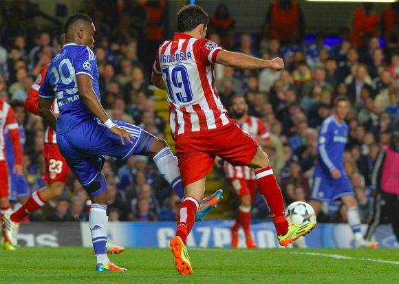 Chelsea's Samuel Eto'o fouls Diego Costa of Atletico Madrid