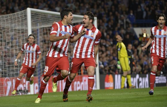 Diego Costa celebrates after scoring