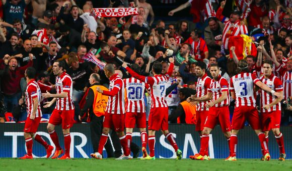 Atletico Madrid players celebrate after winning the game