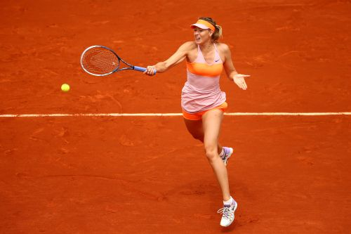 Maria Sharapova of Russia returns a shot during her women's singles quarter-final match against Garbine Muguruza of Spain