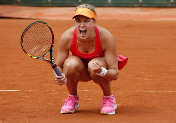 Eugenie Bouchard of Canada reacts after winning her women's quarter-final match against Carla Suarez Navarro of Spain