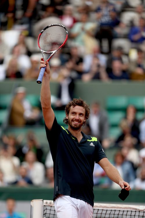 Ernests Gulbis of Latvia celebrates victory in his men's singles quarter-final match against Tomas Berdych