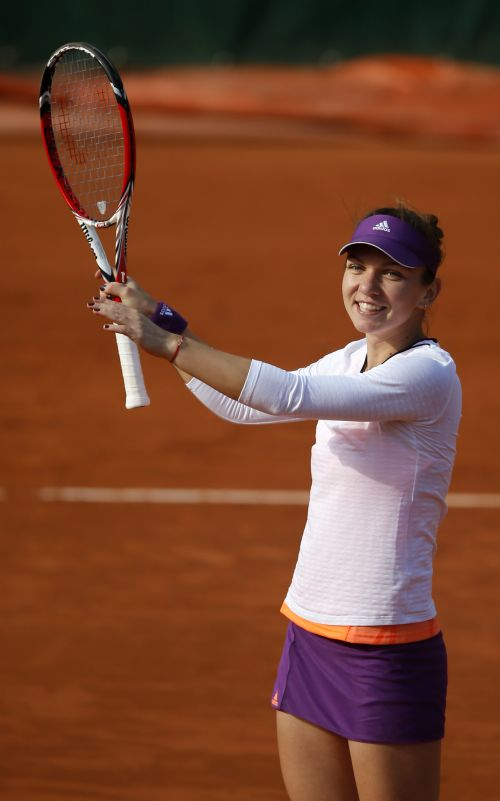 Simona Halep of Romania celebrates after winning her women's quarter-final match against Svetlana Kuznetsova of Russia