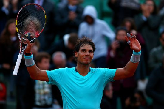 Rafael Nadal of Spain celebrates victory in his men's singles quarter-final match against David Ferrer of Spain
