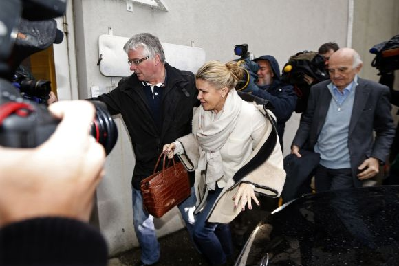 Corinna Schumacher (C), wife of former Formula One world champion Michael Schumacher, and Professor Gerard Saillant (R), president of the Institute for Brain and Spinal Cord Disorders (ICM), arrive at the CHU hospital emergency unit where Schumacher is hospitalized