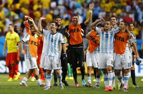 Argentina's Lionel Messi and teammates celebrate winning the 2014 World Cup quarter-finals between Argentina and Belgium