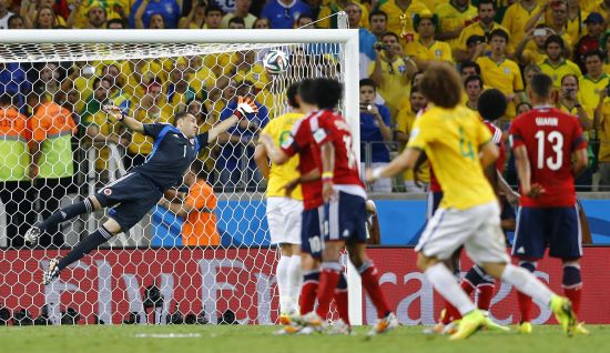 Brazil's David Luiz (No 4) scores from his free-kick past Colombia goalkeeper David Ospina