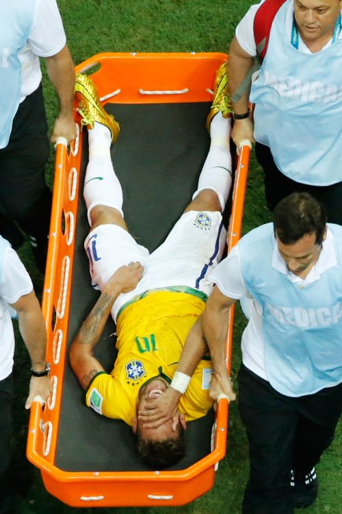 Brazil striker Neymar is stretchered off the pitch after a challenge