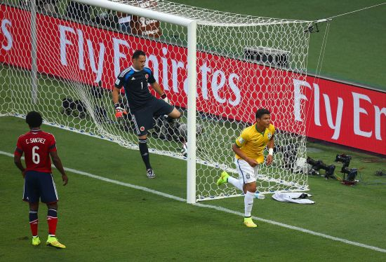 Brazil captain Thiago Silva celebrates after scoring his team's first goal past David Ospina of Colombia