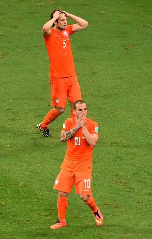 Daley Blind and Wesley Sneijder of the Netherlands react after a missed chance