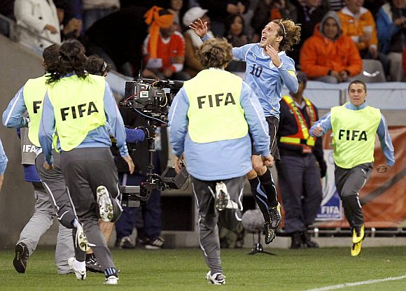 Uruguay's Diego Forlan celebrates after scoring.