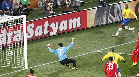 Brazil's Maicon (R) scores past North Korea's goalkeeper Ri Myong-guk