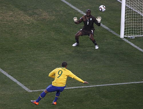Brazil's Luis Fabiano (9) scores as Ivory Coast's goalkeeper Boubacar Barry