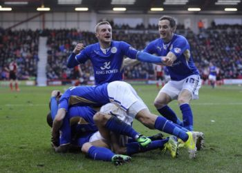 Leicester secure promotion to Premier League