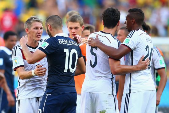 Bastian Schweinsteiger of Germany and Karim Benzema of France greet
