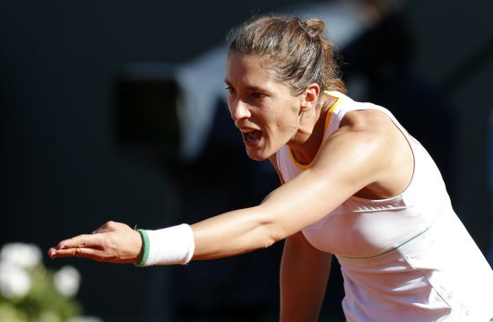Andrea Petkovic of Germany reacts during her women's semi-final match against Simona Halep of Romania
