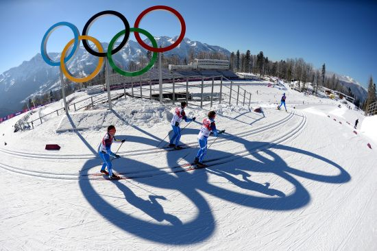 Officials pass the Olympic rings during training ahead of the Sochi 2014 Winter Olympics