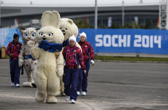 Staff members accompany Olympic mascots in the Athletes Village at the Olympic Park