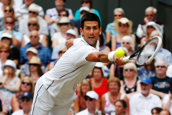 Novak Djokovic of Serbia hits a return
