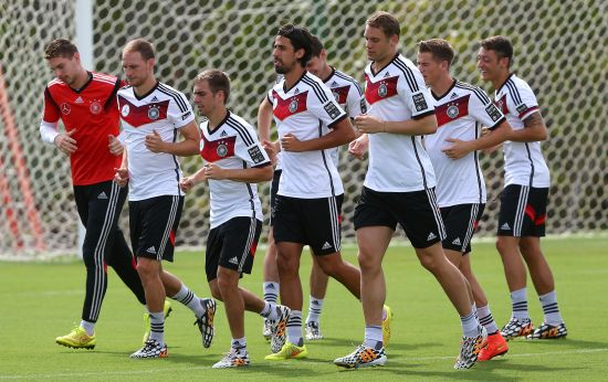 Team members of Germny runs during the German national team training at Campo Bahia