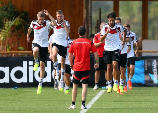 Matthias Ginter (L) and Sami Khedira of Germany jump during the German national team training