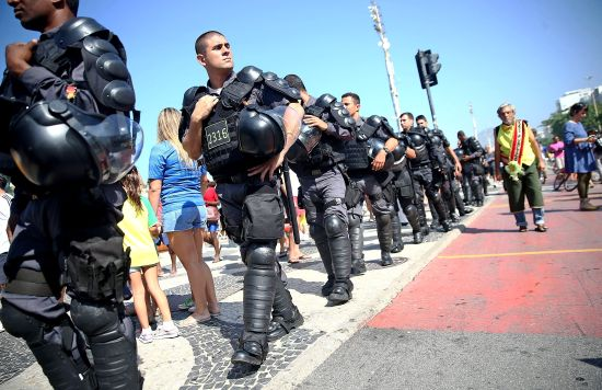 The Brazilian military police keep watch on the crowds in Copacabana
