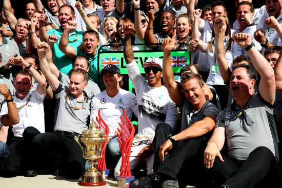 Lewis Hamilton of Great Britain and Mercedes GP celebrates with his team
