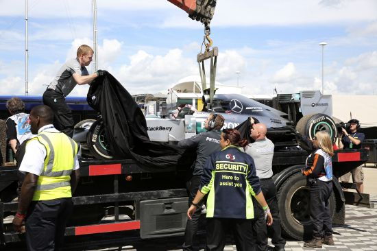 The car of Mercedes Formula One driver Nico Rosberg of Germany is covered after retiring due to gearbox problems