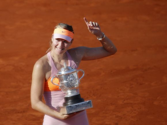 Maria Sharapova of Russia poses with the trophy during the ceremony after defeating Simona Halep of Romania