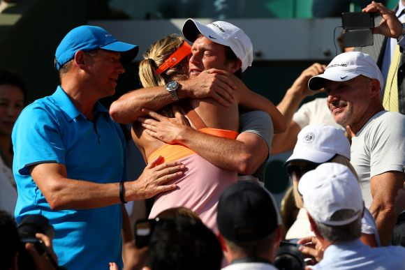 Maria Sharapova of Russia celebrates with her team following her victory in her women's singles final match against Simona Halep of Romania