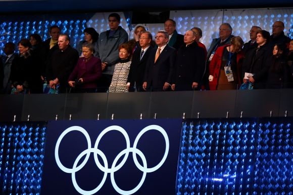 Anne Rogge, husband former International Olympic Committee (IOC) President Jacques Rogge, Yoo Soon-taek, Claudia Bach, UN Secretary General Ban Ki-moon, IOC President Thomas Bach and Russian President Vladimir Putin stand during the Opening Ceremony of the Sochi 2014 Winter Olympics
