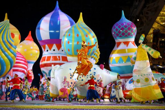 Dancers perform with inflated objects during the Opening Ceremony of the Sochi 2014 Winter Olympics