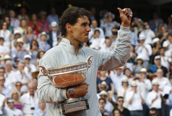 Rafael Nadal of Spain holds the trophy during the ceremony after defeating Novak Djokovic of Serbia