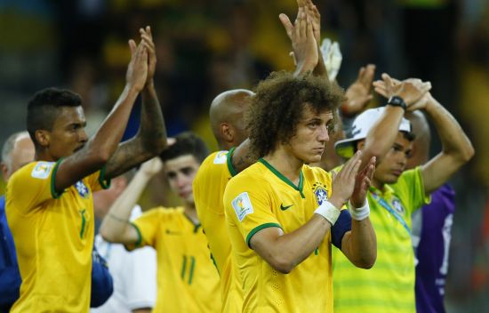 Brazil's Luiz Gustavo (L), David Luiz (C) and Thiago Silva (rear R) acknowledge the crowd after their 2014 World Cup semi-finals against Germany