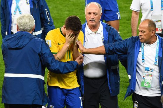 Head coach Luiz Felipe Scolari of Brazil and staff console Oscar