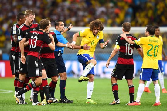 David Luiz of Brazil protests to referee Marco Rodriguez after a challenge