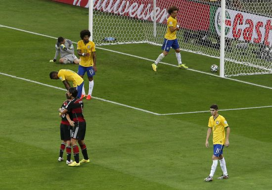 Brazilian players react after conceding a goal