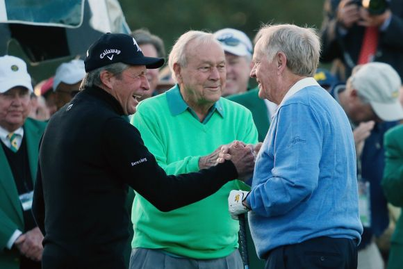 Honorary starters Gary Player, Arnold Palmer and Jack Nicklaus greet each other on the first tee at the start of the first round of the 2014 Masters Tournament at Augusta National Golf Club