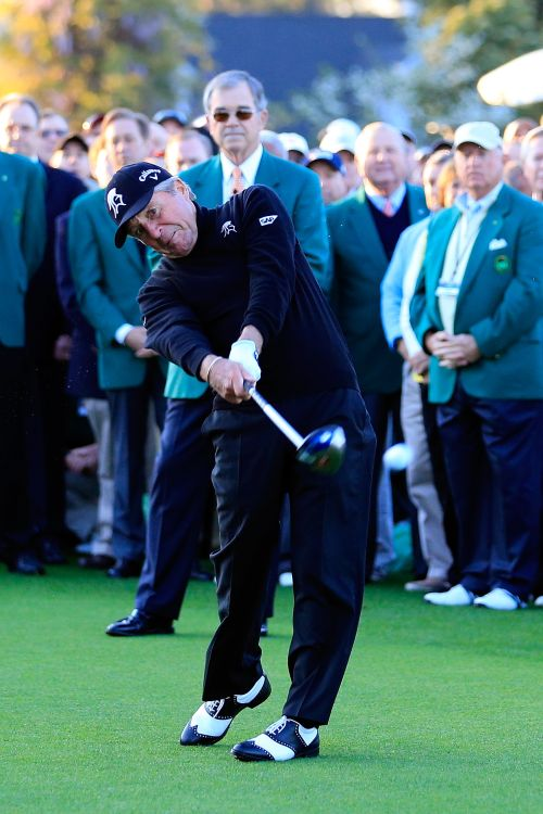 Honorary starter Gary Player of South Africa hits a tee shot on the first hole at the start of the first round of the 2014 Masters Tournament